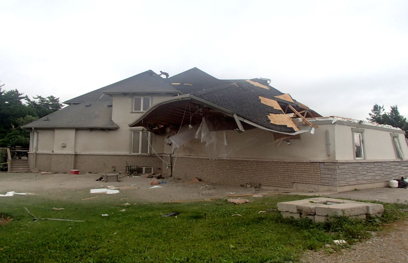 Tornado Damage Completely Separated Roof From House